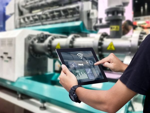 Smart industry control concept.Hands holding tablet on blurred a