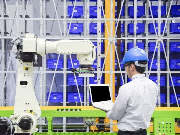 The programmer engineer control the robot for logistic warehouse